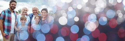 Family smiling outside with red and blue bokeh transition Stock Photo
