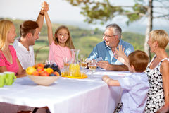 Family smiling and playing card in nature Stock Images
