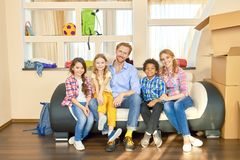 Family smiling, relocation. Happy people and cardboard boxes. Stress free moving royalty free stock images
