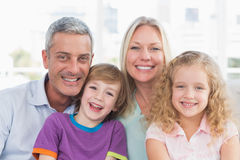 Family smiling together at home Royalty Free Stock Photos