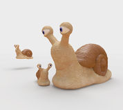 Family of snails on walk. Royalty Free Stock Images
