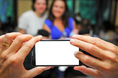 Family snapshot. Taking a snapshot using a touch screen phone Royalty Free Stock Photos