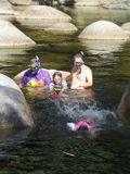 Family Snorkeling expedition. Family snorkeling in a mountain stream Royalty Free Stock Image