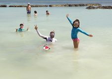 Family snorkeling in Fatima Bay. Pictured is a family snorkeling in Fatima Bay in Puerto Aventuras, Mexico. They are expressing the good time they are having stock photo
