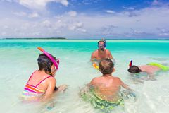 Family snorkeling in sea Stock Photos
