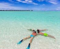 Family snorkeling in sea stock photo