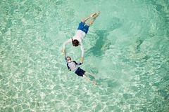 Family snorkeling together stock images