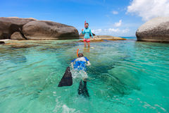 Family snorkeling in tropical water Stock Photo
