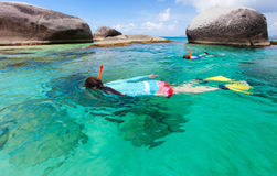 Family snorkeling at tropical water Stock Photos