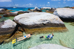 Family snorkeling at tropical water Royalty Free Stock Photos