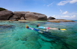 Family snorkeling at tropical water Royalty Free Stock Image