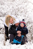 Family in the snow Royalty Free Stock Photography