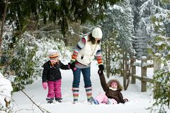 Family in snow. A Mom and her kids playing in the snow Royalty Free Stock Images