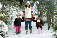 Family in snow. A Mom and her kids playing in the snow Royalty Free Stock Image