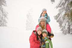 Family in the snow Royalty Free Stock Photo