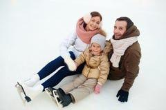 Family on snow Royalty Free Stock Photos