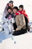 Family on snow Royalty Free Stock Photo