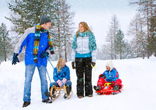 Family-snow-fun 02. Family is sledging in winterlandscape Royalty Free Stock Photo