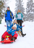Family-snow-fun 03. Family is sledging in winterlandscape Stock Photo