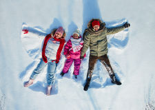 Family in snow Stock Images
