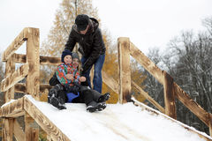 Family on snow saucer Royalty Free Stock Images