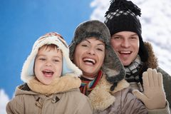 Family in snow at winter Royalty Free Stock Photo