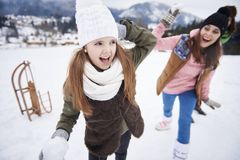 Snowball fight. Family snowball fight in winter royalty free stock image