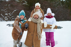 Family in snowdrift royalty free stock photography