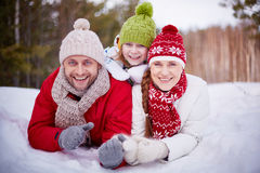 Family in snowdrift Royalty Free Stock Photos