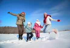 Family in snowdrift Stock Photography