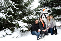 Family with snowman Christmas tree Stock Photo