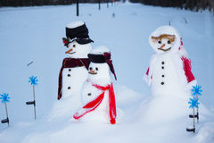Family of snowmen. In the countryside Stock Images