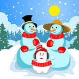 Family snowmen Dad mom and son. Stock Photography