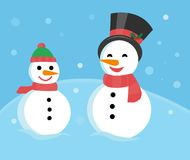 Family of snowmen - father and son snowmen in caps and scarves Stock Photo