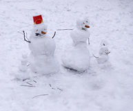 Family snowmen of four figures Royalty Free Stock Photo