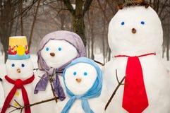 Family of snowmen outdoors Royalty Free Stock Image