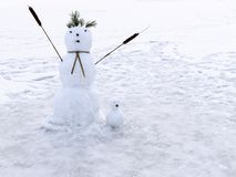 Family snowmen of two figures Royalty Free Stock Image