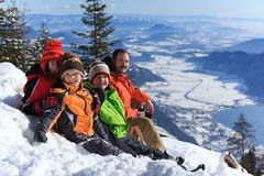 Family on snowy mountain Stock Images
