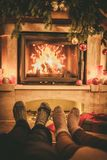 Family in socks near fireplace Royalty Free Stock Image