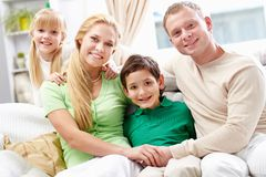 Family on sofa Royalty Free Stock Photography