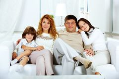 Family on sofa Stock Image