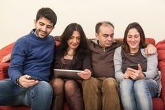 Family on the Sofa Stock Photography