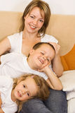 Family on the sofa Royalty Free Stock Images