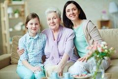 Family on sofa Royalty Free Stock Image