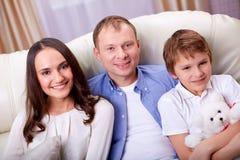 Family on sofa Stock Photos