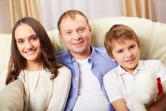 Family on sofa Stock Photo