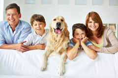 Family on sofa stock images