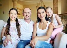 Family on sofa Royalty Free Stock Photography