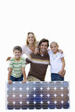 Family with solar panel, smiling, portrait, cut out Stock Images