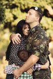 Family and soldier in a military uniform Stock Images